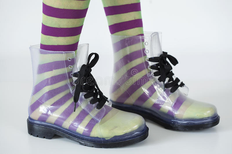 Woman stands with gumboots on white background royalty free stock photography