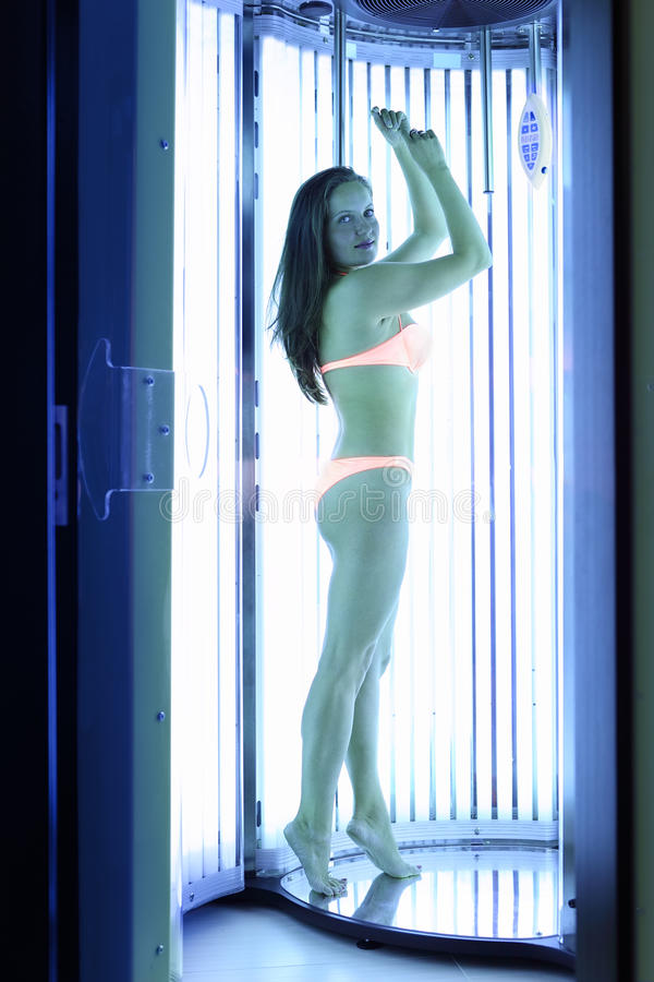 Download Woman Stands In Solarium And Looks Stock Photo - Image: 25096466