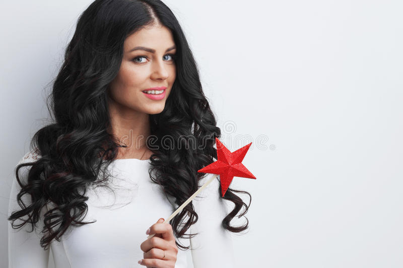 Woman with star shaped magic wand royalty free stock photo