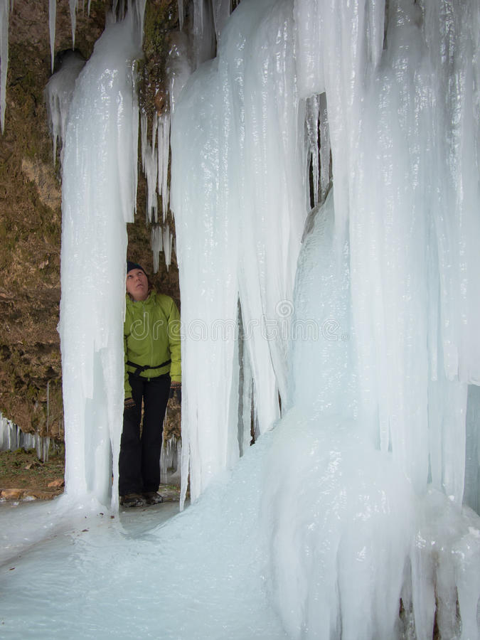 Woman stares up at the icicle stock image