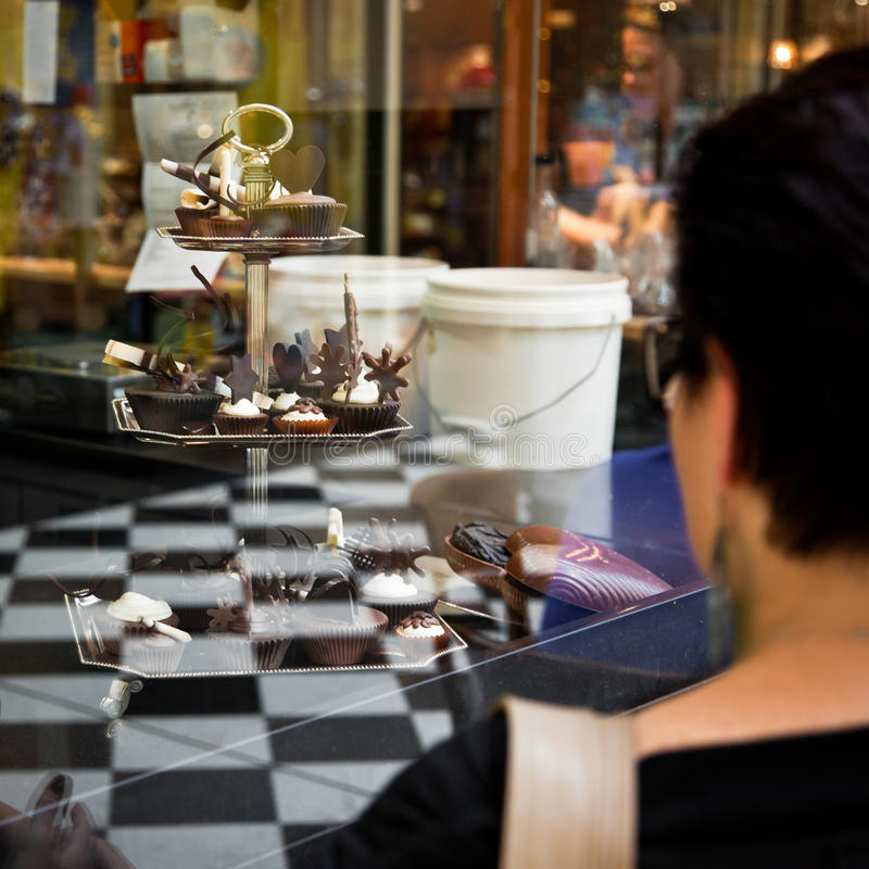 Download Woman Staring At Chocolates Stock Photo - Image: 18131168