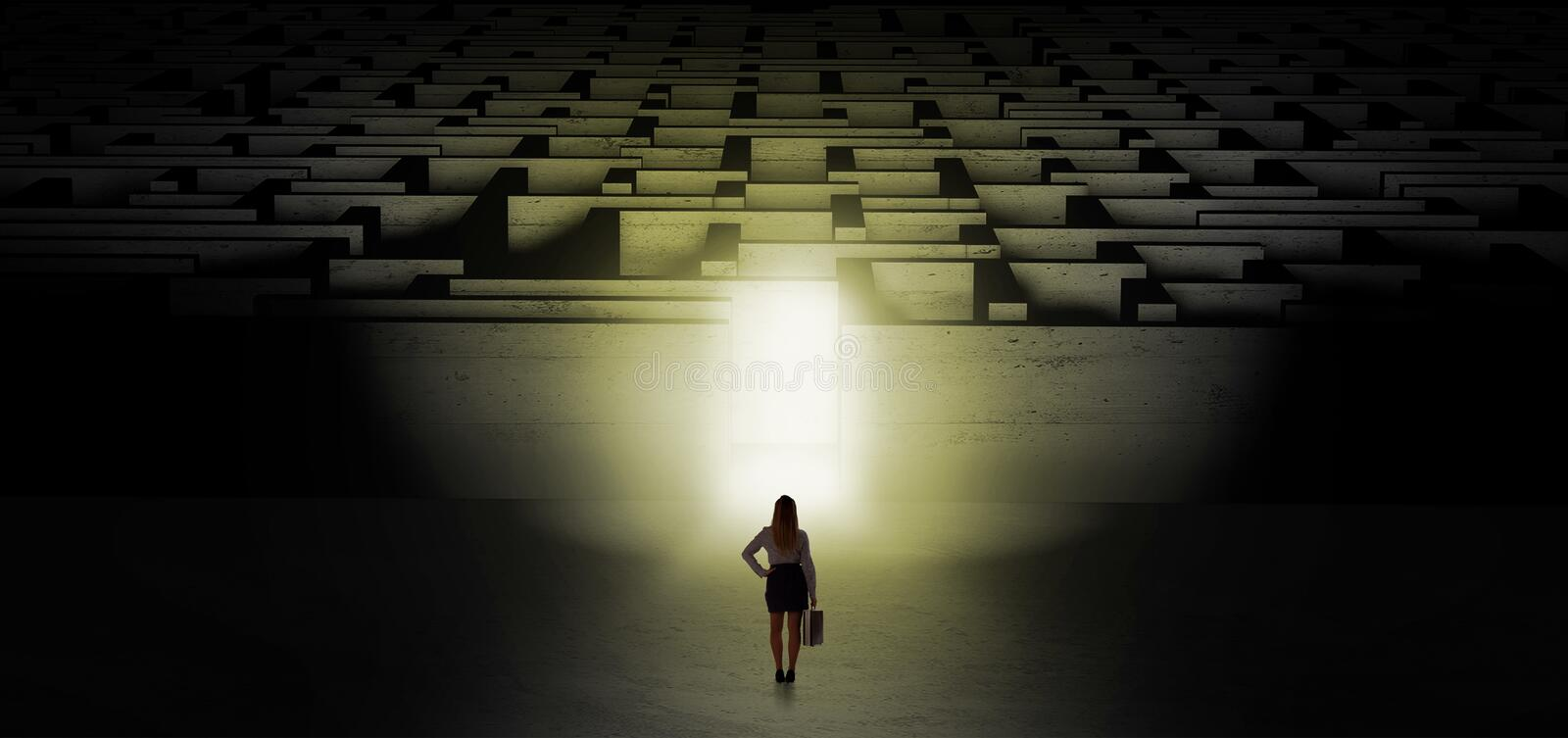 Woman starting a dark labyrinth challenge. Woman getting ready to enter the dark labyrinth with illuminated door stock images