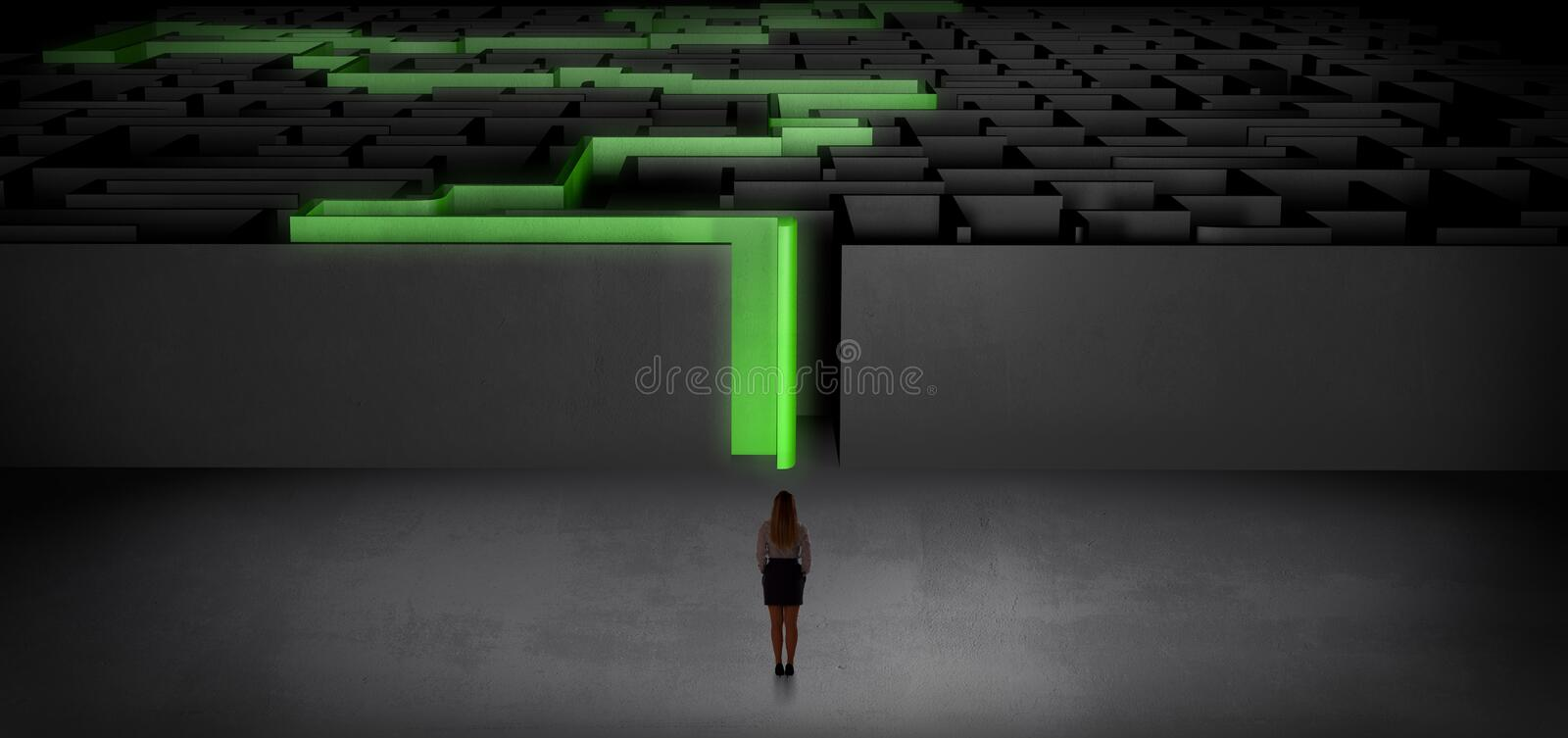 Woman starting a stated dark labyrinth. Woman getting ready to enter the dark labyrinth with stated road concept stock photography