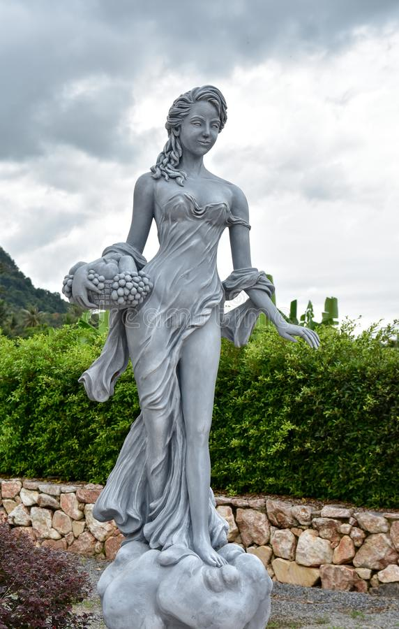 Woman statue with angels in Villa Giulia royalty free stock image