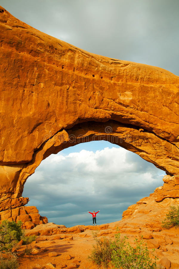 Download Woman Staying With Raised Hands Inside An Arch Stock Image - Image: 25421159