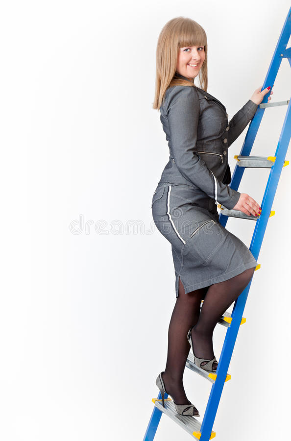 Download A Woman On A Stepladder Stock Photography - Image: 19300622