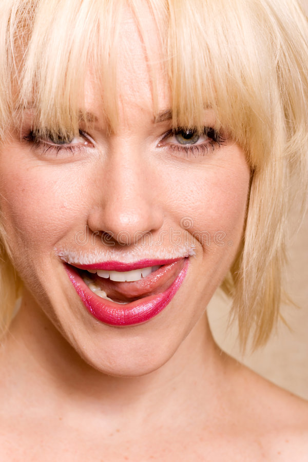 Woman Sticking Her Tongue Out Stock Photo - Image of