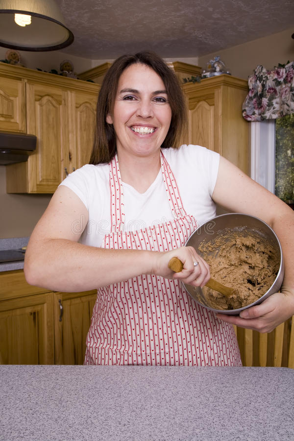 Woman Stirring Cookie Dough Stock Photos