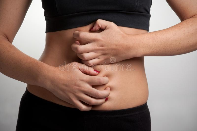 Woman with a Stomach Ache royalty free stock photo