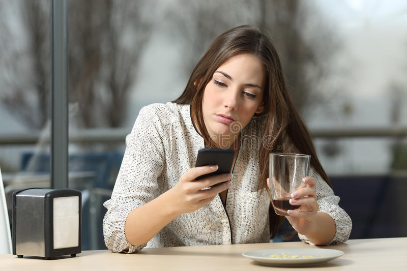 Woman stood up in a coffee shop stock images