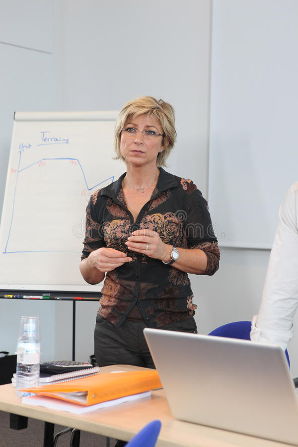 Woman Stood By Whiteboard Royalty Free Stock Photography
