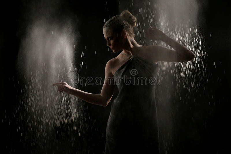 Woman With Stop Motion Of Explosive Powder Captured By Flash Royalty Free Stock Photo