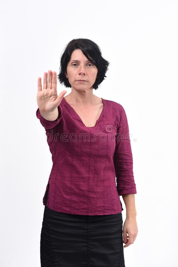 Woman with stop sign on white background stock photography
