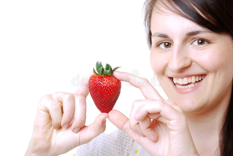 Woman with a strawberry royalty free stock images