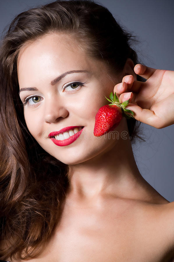 Download Woman with strawberry stock image. Image of people, color - 25477639