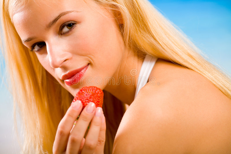 Woman with strawberry stock photos
