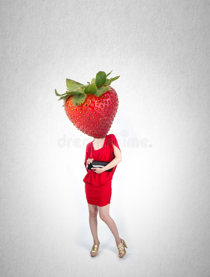 Woman and strawberry with concept on a background. royalty free stock photo