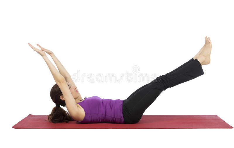 Woman strengthening her abs during fitness royalty free stock images