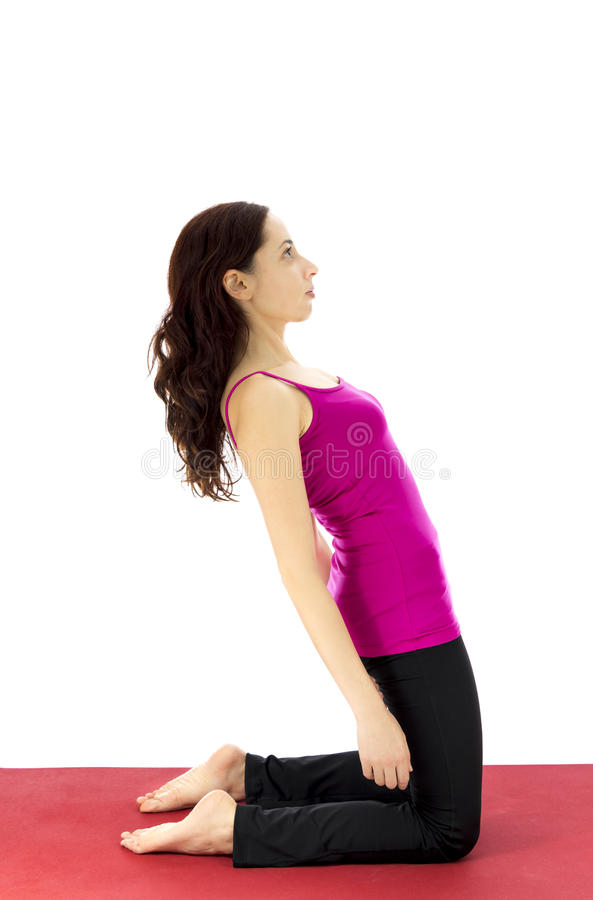 Woman strengthening the upper leg muscles royalty free stock photography