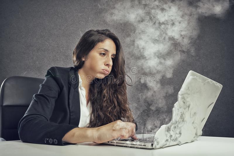 Woman stressed by overwork with the laptop melting stock photos