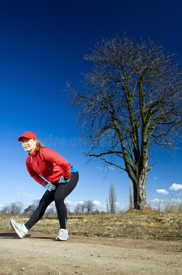 Download Woman Stretches After Cross Country Running Stock Image - Image: 18768399