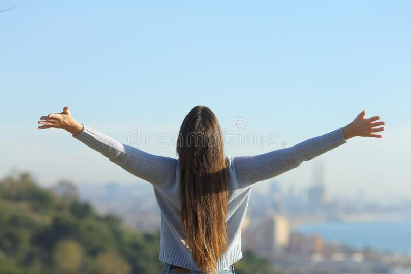 Woman stretching arms looking at city background royalty free stock images