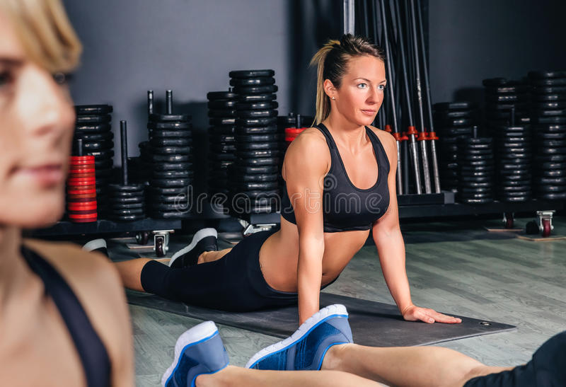Woman stretching back in a fitness class royalty free stock photography
