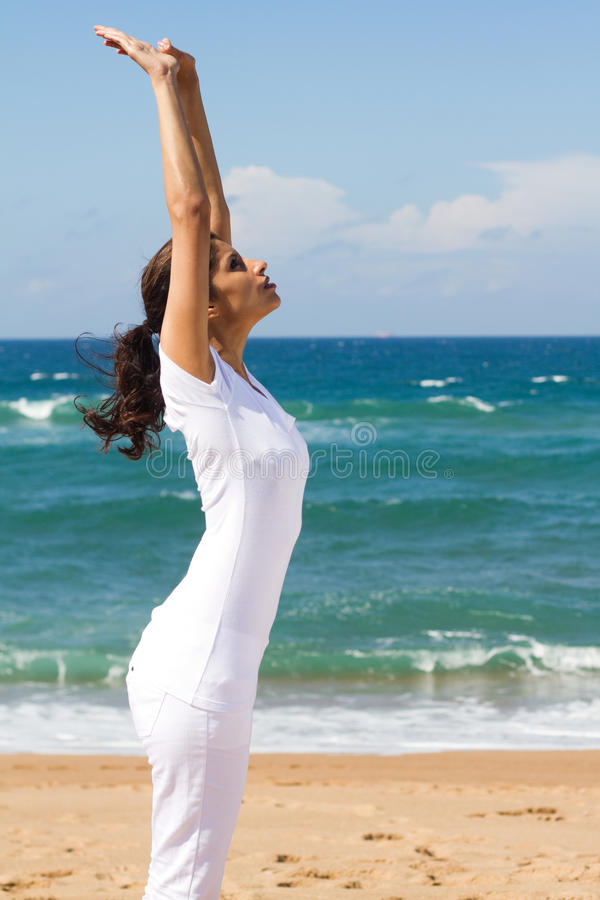 Woman stretching on beach royalty free stock images