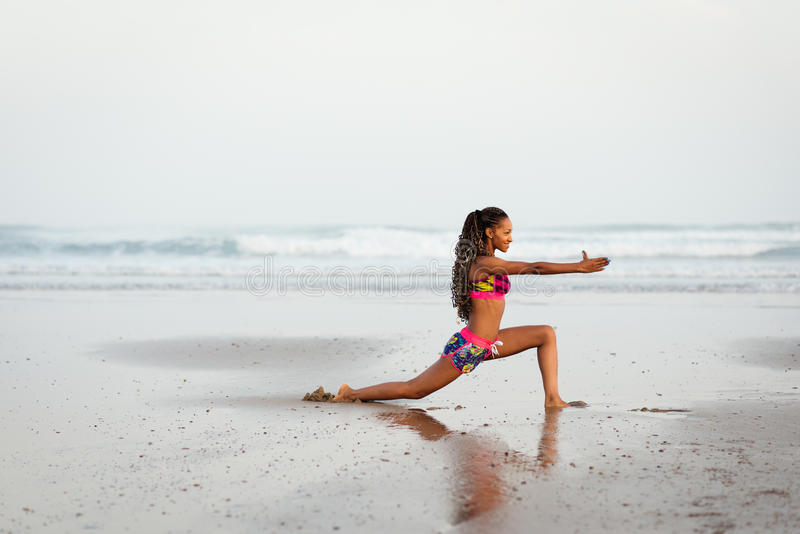 Woman stretching and doing yoga exercise stock images