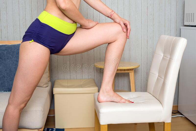 Woman stretching with foot royalty free stock photos