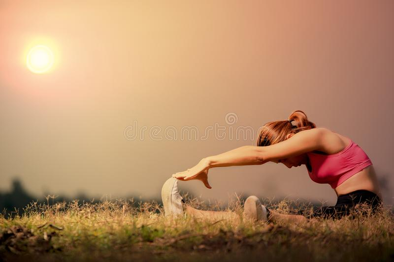Woman stretching hamstring royalty free stock photo