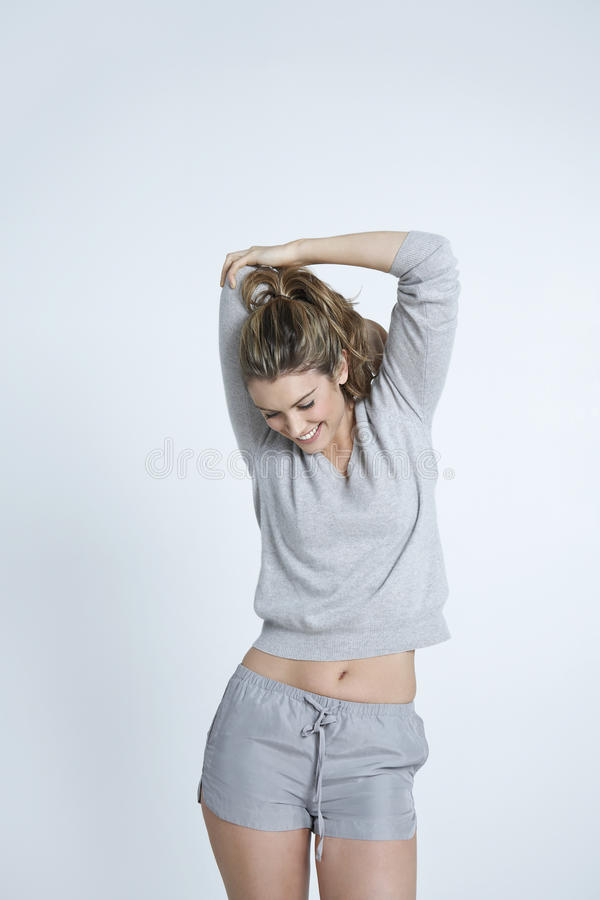 Woman Stretching Hand Against Colored Background stock photos