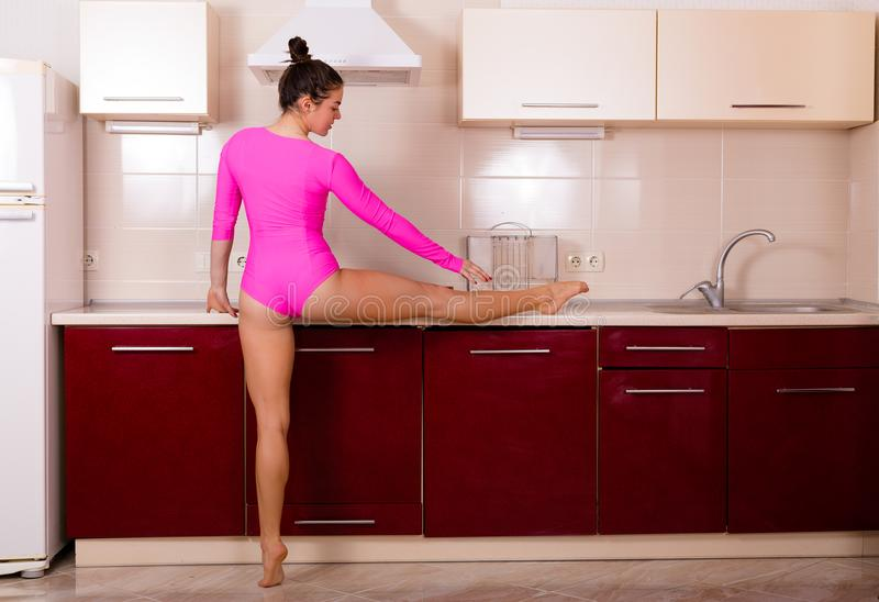 Woman stretching at home royalty free stock photo