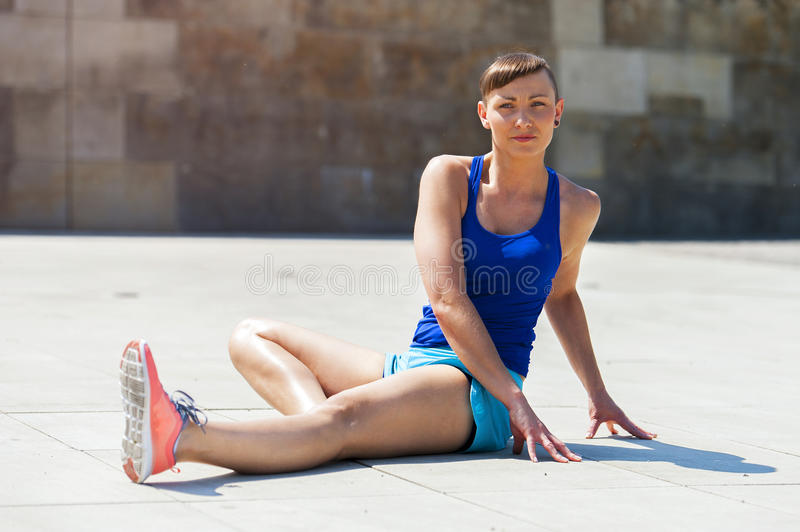 Woman stretching after, before jogging. Fit active stock photography