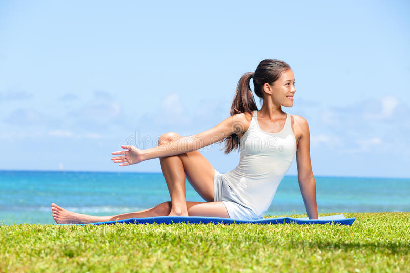 Woman stretching legs in yoga exercise fitness royalty free stock photography