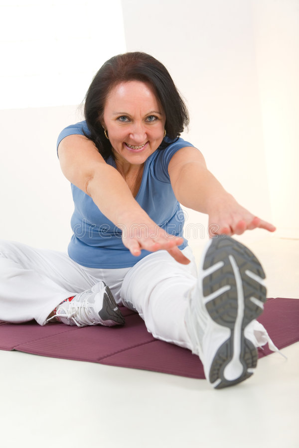 Free Woman Stretching On Mat Royalty Free Stock Photo - 8869075