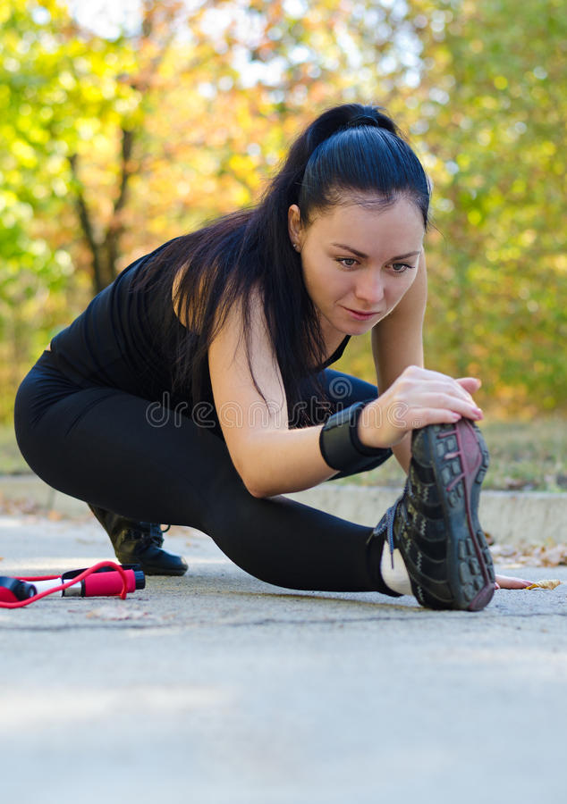 Woman Stretching Before Training Royalty Free Stock Image