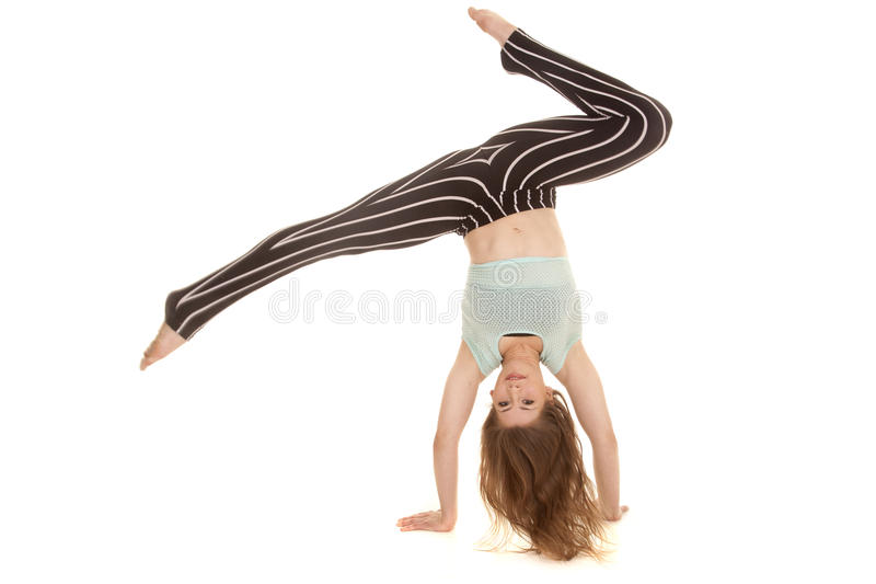 Woman stripe pants dance hands down legs up royalty free stock images