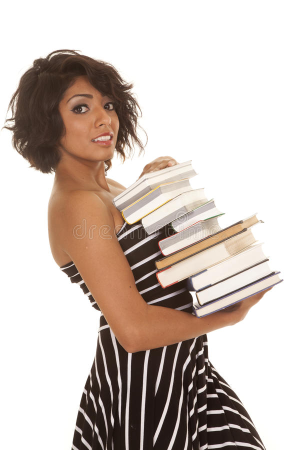 Woman Striped Dress Stack Of Books Serious Side Royalty Free Stock Photography