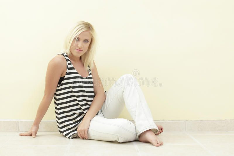 Woman In A Striped Shirt Stock Photo