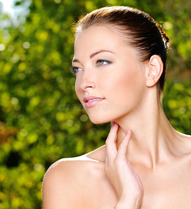Woman Stroking Her Fresh Clean Skin Of Face Stock Photos