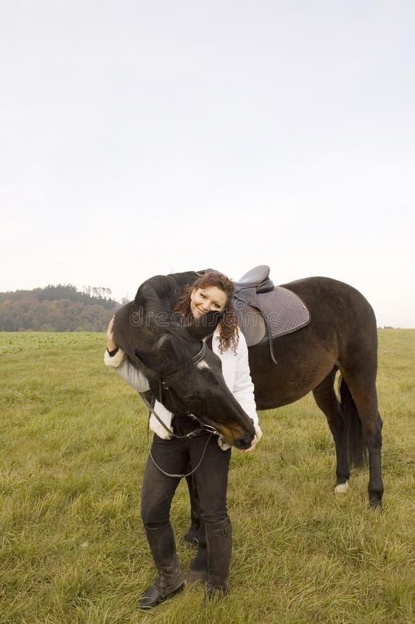 Woman Stroking Horse. Royalty Free Stock Photos