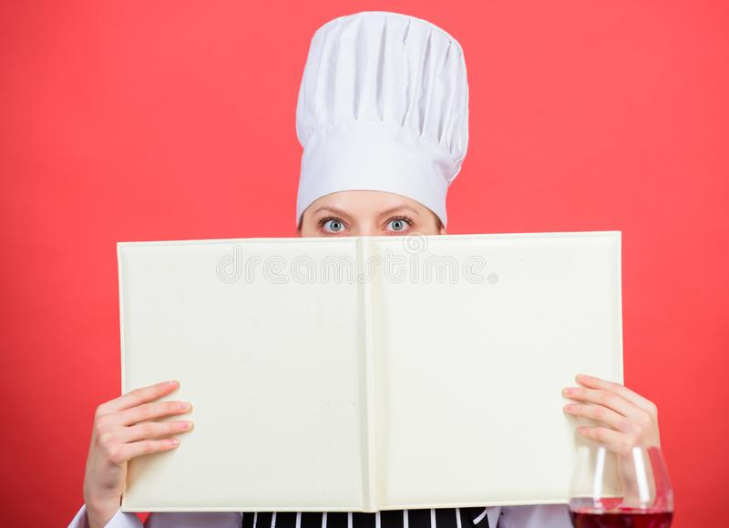 Woman study culinary. Culinary expert. Chef cooking healthy food. Cooking techniques. Cook read book best culinary. Recipes. Culinary school concept. Book by stock photos