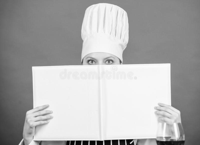 Woman study culinary. Culinary expert. Chef cooking healthy food. Cooking techniques. Cook read book best culinary. Recipes. Culinary school concept. Book by stock photo