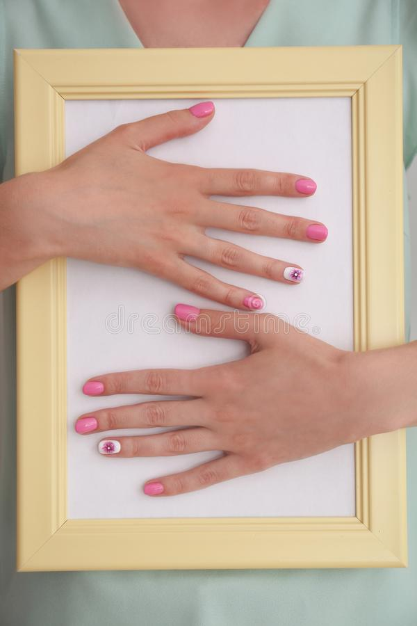 Woman with stylish color nails holding empty photo frame, closeup stock images