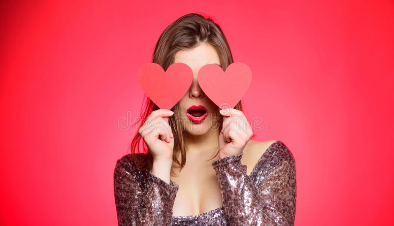 Woman in stylish dress hold symbol love. Romantic mood. Girl in love dating. Obsession concept. Fall in love. Girl. Adorable fashion model makeup face hold stock photography