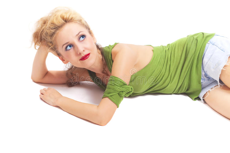 Woman with stylish hair lying on  white background