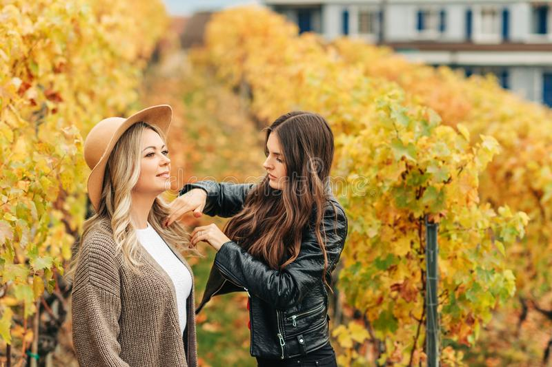 Woman stylist preparing beautiful woman model for photo session royalty free stock images