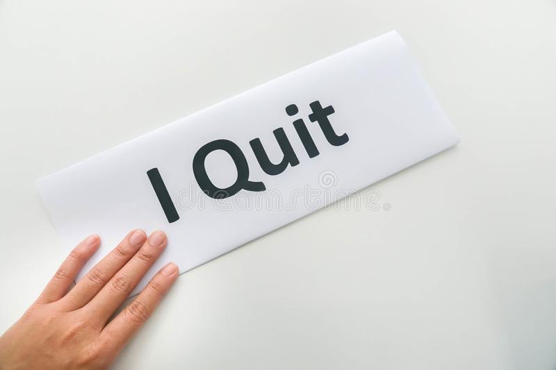 Woman submit resignation letter of I quit in office. Isolated woman submit resignation letter of I quit in office royalty free stock photography