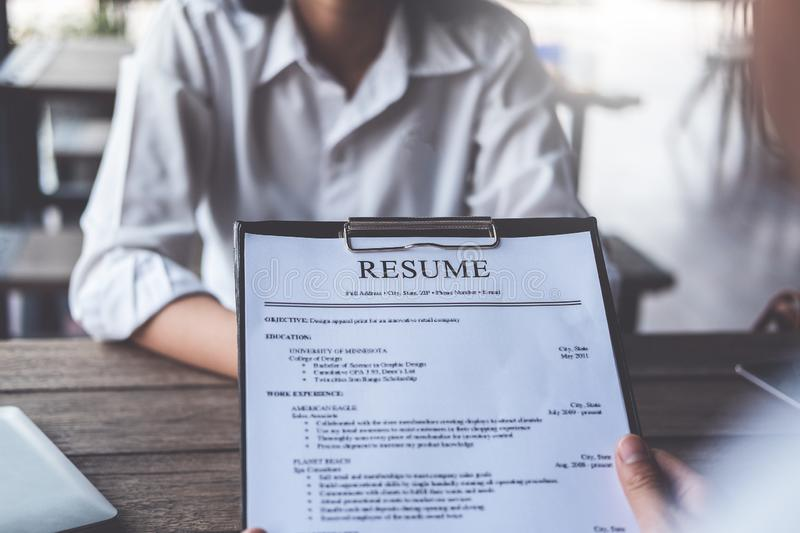 Woman submits job application, Interviewer reading a resume stock photography